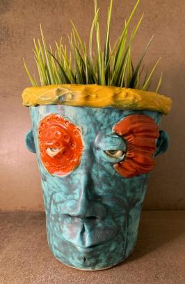 Colorful and whimsical ceramic face planter available on Etsy
